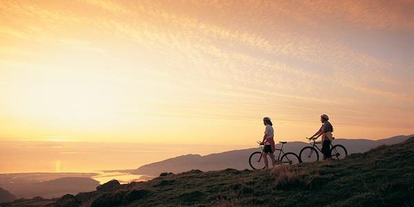 Cyclists looking down over Barmouth and the Mawddach Estuary