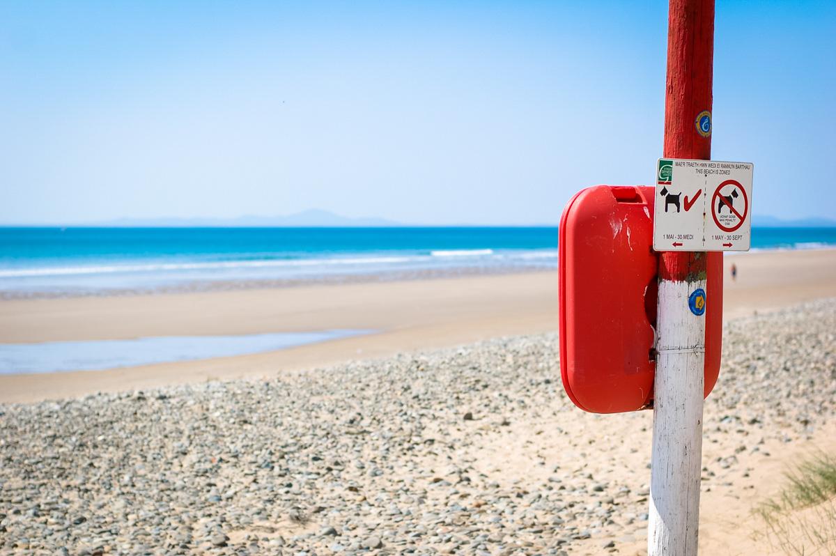 Life ring on a sandy beach