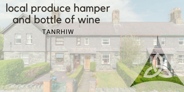 local produce hamper and bottle of wine